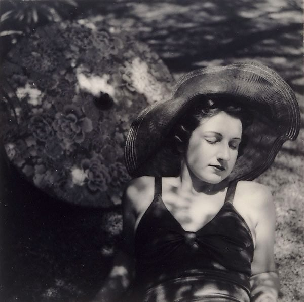 An image of Untitled (Woman in sun hat with parasol)