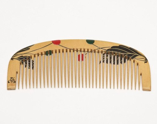 An image of Comb with plant design by