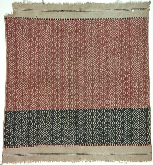 An image of Ceremonial textile (tampan) with abstract repeat pattern in red and blue by