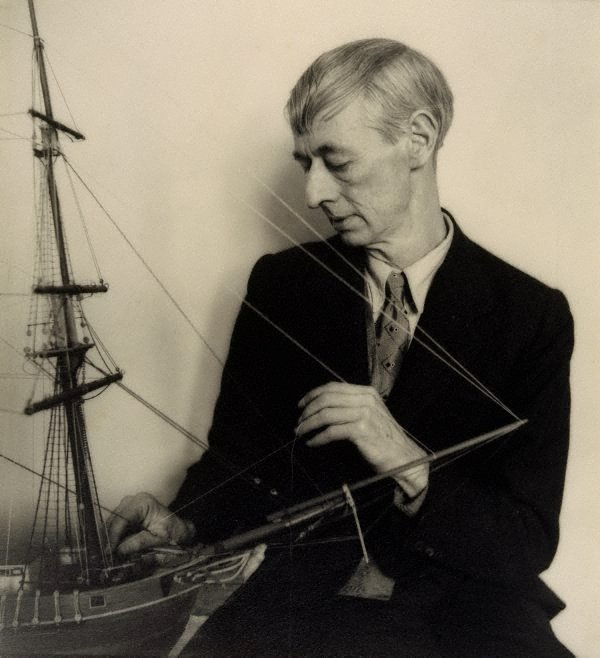 An image of Norman Lindsay (with model ship - close up)