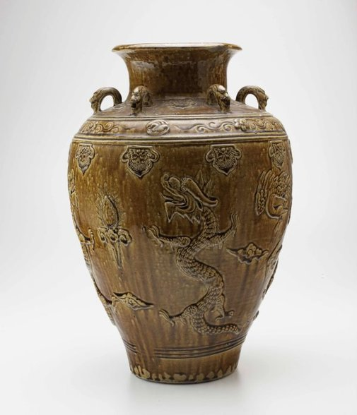 An image of Martaban urn with dragon design by
