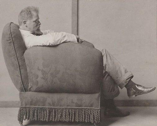An image of Max Klinger in an armchair by attrib. Nicola Perscheid
