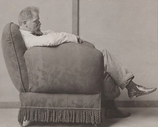 An image of Max Klinger in an armchair
