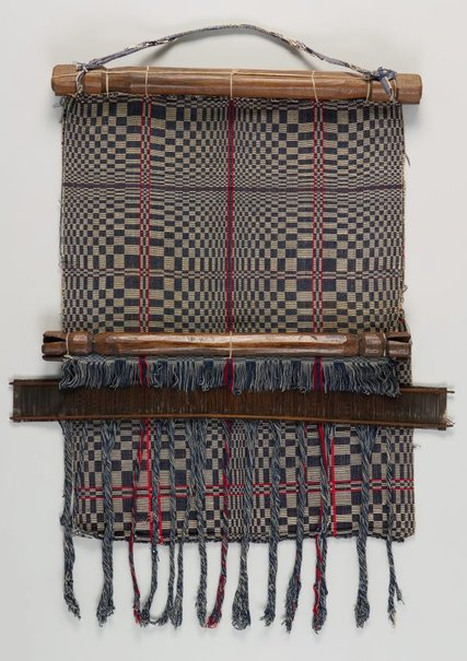 An image of Back-strap loom with section of blanket (owes) by Itneg