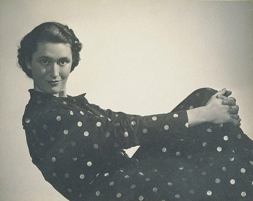 An image of Untitled (Vesta Davies in spotted dress, hands around knee) by Max Dupain