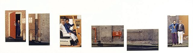 An image of Untitled (Man coming out of red door; drain pipe, man and woman in forklift, fire hose, wall and window ledge, man and woman on step. Yarraville sugar refinery)
