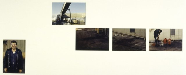 An image of Untitled (Man in workclothes, conveyor, ground, ground and corrugated wall, man and hoses)
