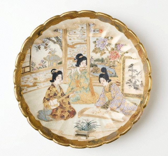 An image of Plate with design of three women playing musical instruments