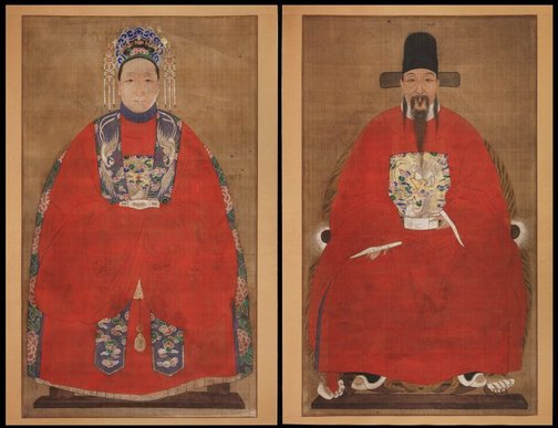 An image of A pair of husband and wife ancestor portraits by