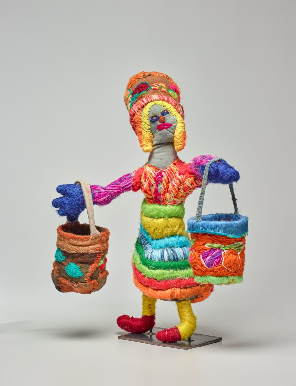 An image of Woman with Dilly Bags and Dilly Bag Hat