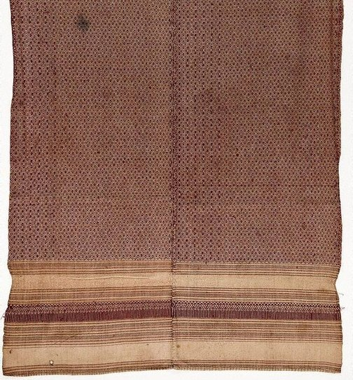 An image of 'Phaa hom' (blanket) with diamond and star patterns by