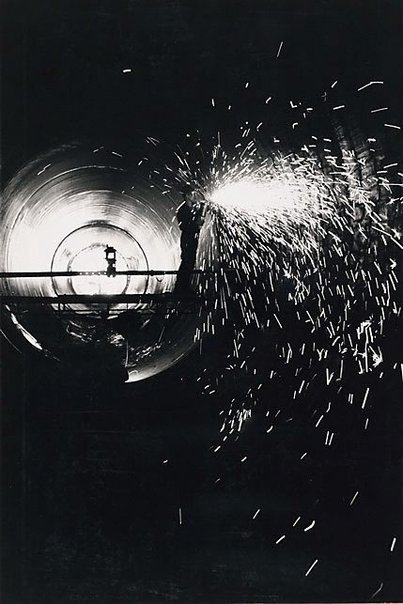 An image of Grinding pipe weld in Snowy Mountains Scheme by David Moore