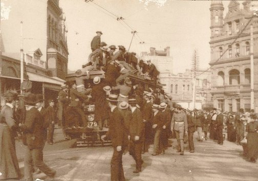 An image of Untitled (people clambering on tram to go up to Rose Bay Heights to view the arrival of the 'great white fleet', 27 August 1908) by James S Stening