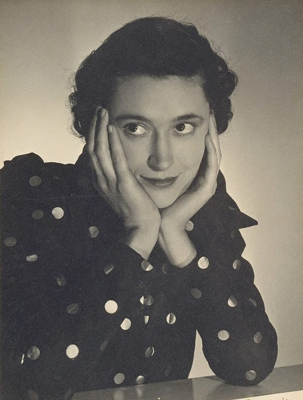 An image of Untitled (Vesta Davies, spotted dress, hands on face)