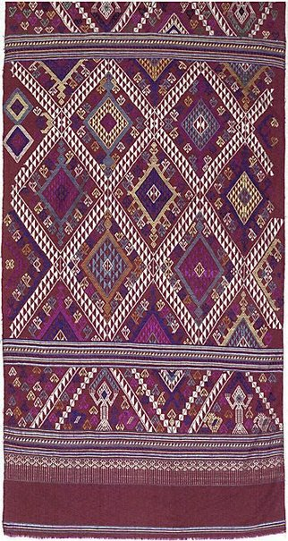 An image of Curtain with diamond pattern and ancestral figures by