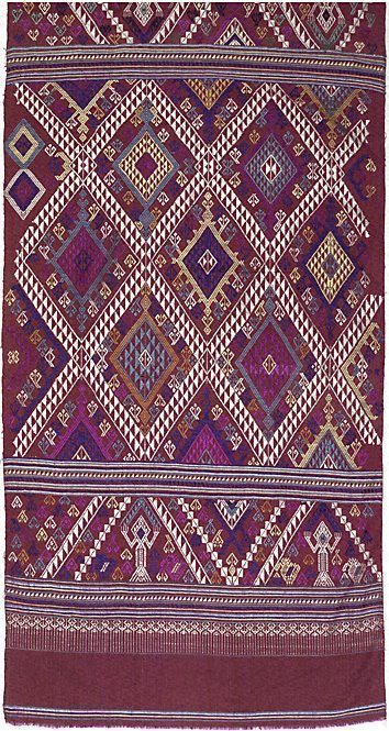An image of Curtain with diamond pattern and ancestral figures