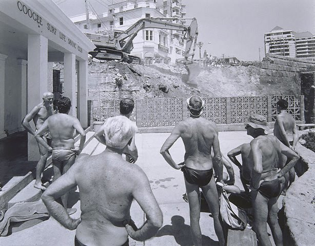 An image of Men watching excavation beside Coogee Surf Club, New South Wales