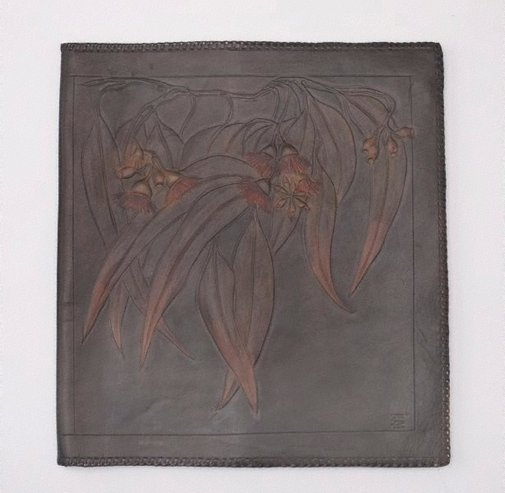 An image of Leather blotter with gum flower, leaf and nut design by Edith Sansom