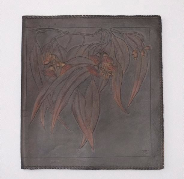 An image of Leather blotter with gum flower, leaf and nut design
