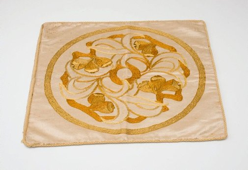 An image of Cushion cover with gumnut and leaf design by Eirene Mort