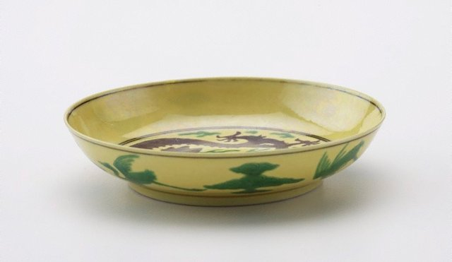 An image of Yellow-ground dish decorated with green and aubergine dragons