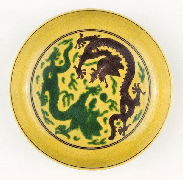 An image of Yellow-ground dish decorated with dragon design