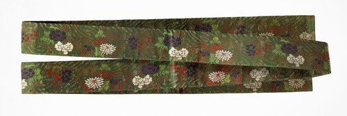 An image of Koshimaki obi (sash) with cherry blossoms, narcissus, peonies and stylised wave by