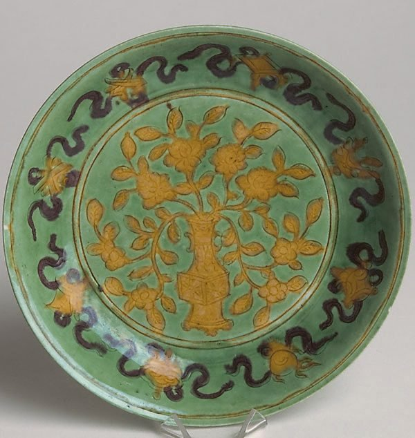 An image of Saucer dish with incised detailing, decorated in centre with vase of flowers; reverse with frieze of 'lingzhi' sprigs