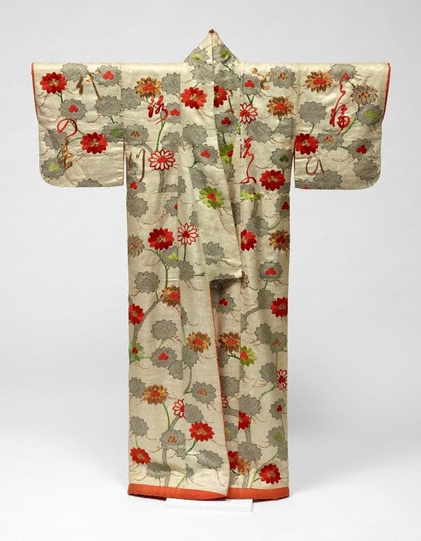 An image of Kosode (small-sleeve kimono) with design of blossoming trees and scattered poem on white figured silk satin ('rinzu')