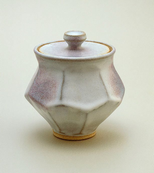 An image of Jar with cut sides, white chun glaze and copper red splashes