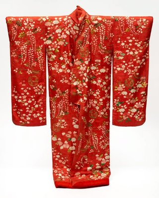 AGNSW collection Furisode uchikake (long-sleeve overcoat) with design of plum and cherry blossoms, peonies, chrysanthemums and wisteria on red figured silk satin ('rinzu') (19th century) 243.2014