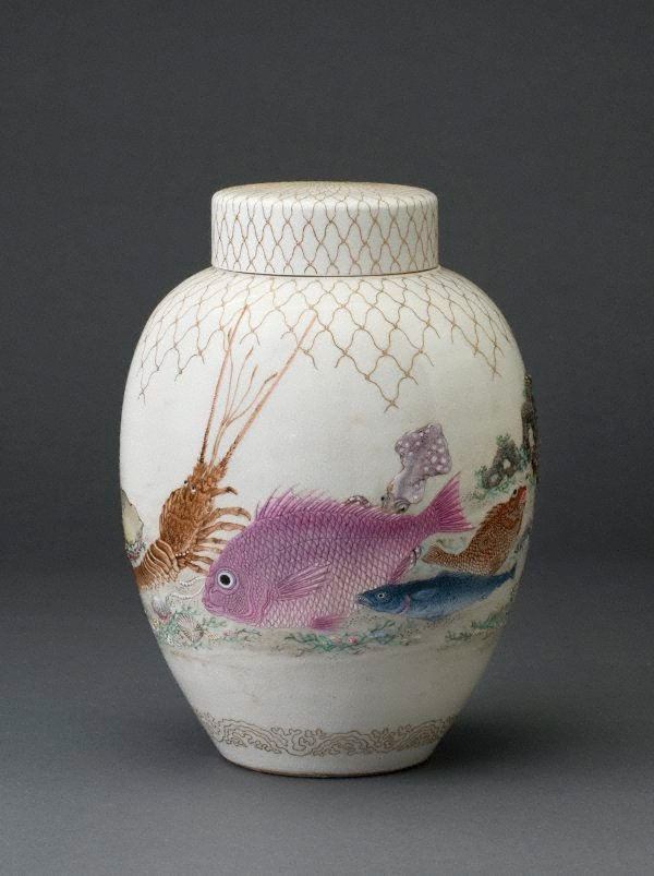 An image of Jar with design of sea creatures and net in relief