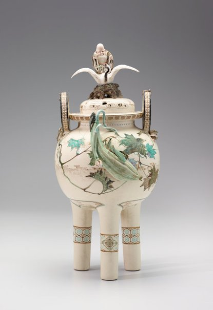 An image of Three footed vase with design of gourds, insects and frogs by Meiji export crafts