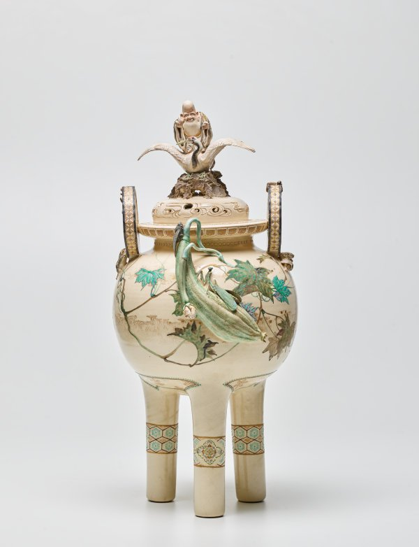 An image of Three footed vase with design of gourds, insects and frogs