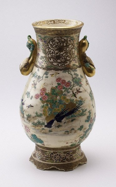An image of Vase with design of birds and flowers around pond