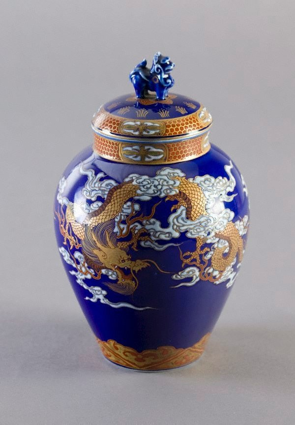 An image of Tea jar with design of dragon and pheonix in clouds