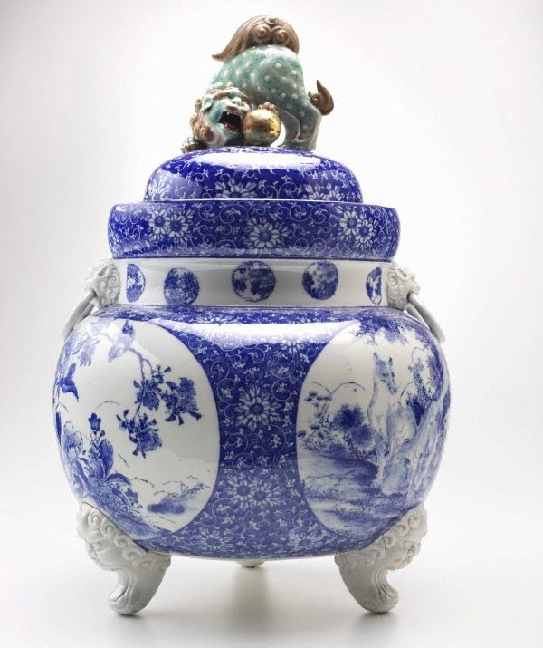 An image of Lidded tripod urn with a lion dog (shishi) finial