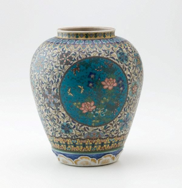 An image of Jar with design of butterflies and flowers