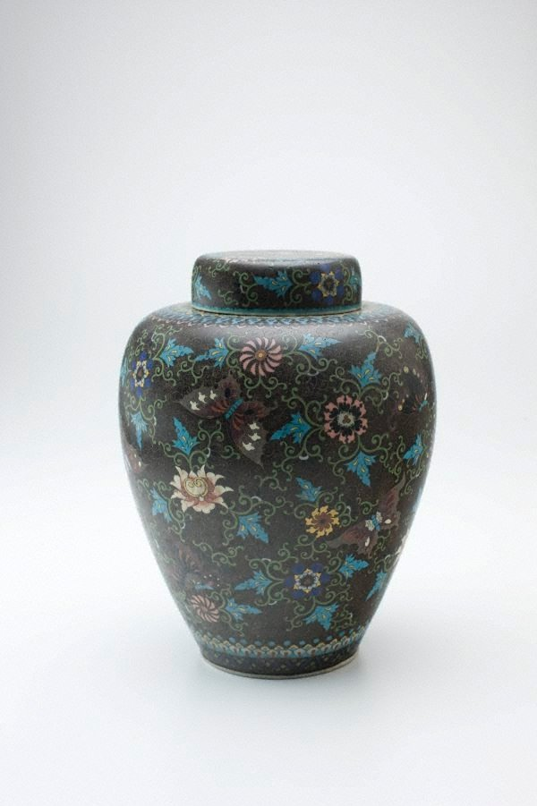 An image of Ginger jar with design of butterflies and flowers