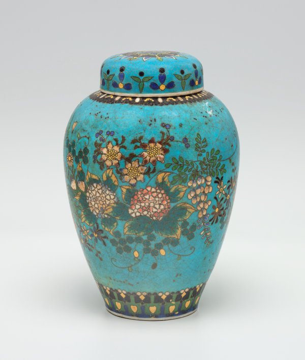 An image of Tea jar decorated with flowers