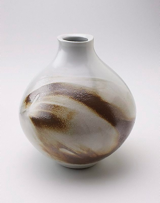 An image of Vase with white glaze and slip decoration