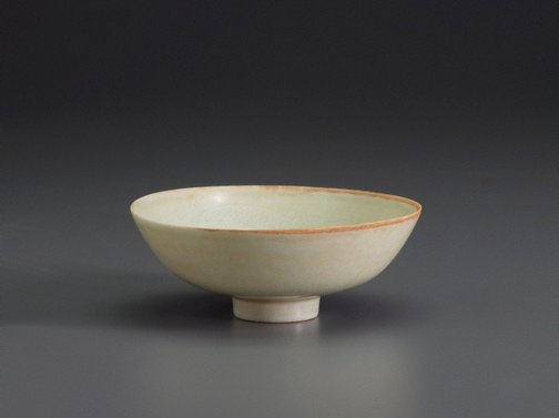 An image of Shallow bowl on small foot decorated with incised design of two dragons around flaming pearl by Jingdezhen ware