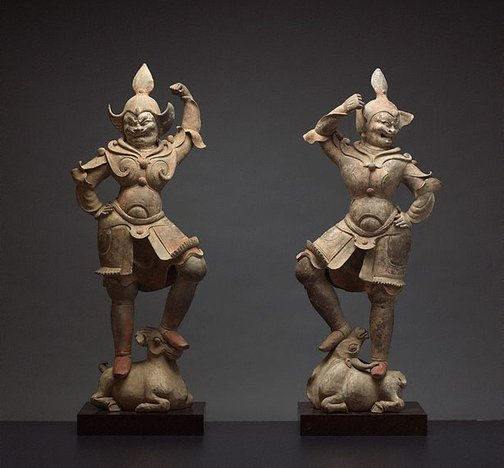 An image of A pair of tomb guardian figures by