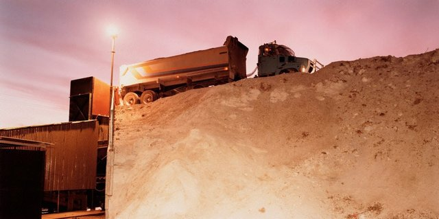 An image of Truck waiting to dump a load of gypsum into the crusher's hopper
