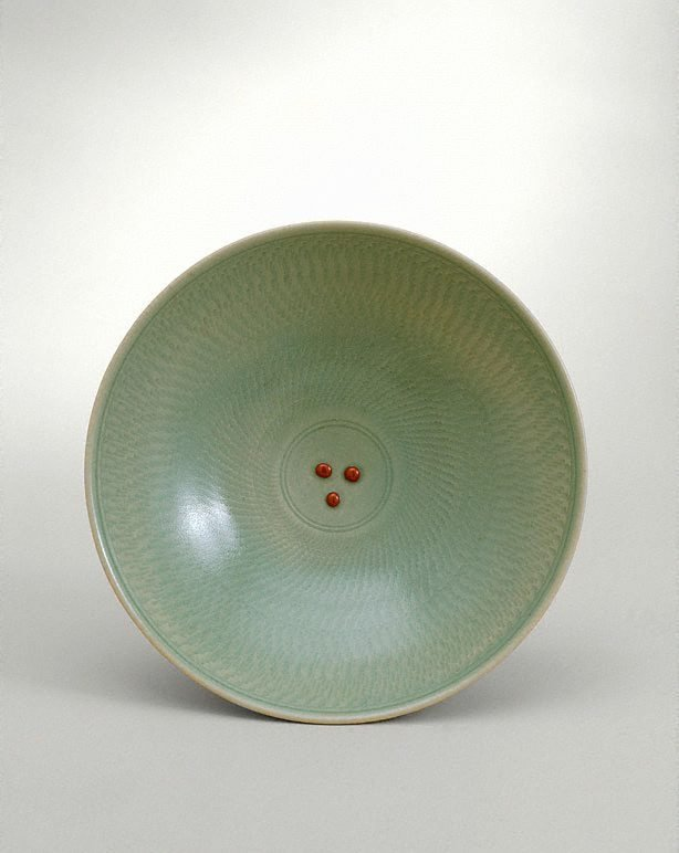 An image of Bowl with celadon glaze and chattered decoration with three red dots