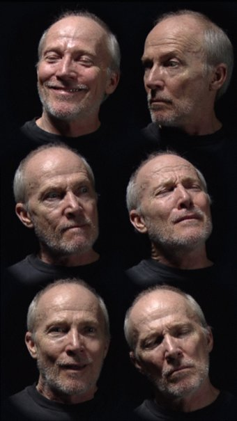 An image of Six heads by Bill Viola