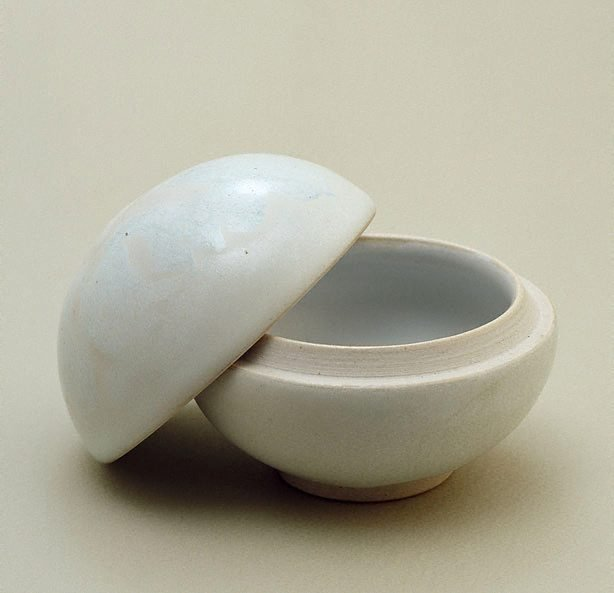 An image of Medicine box with white glaze