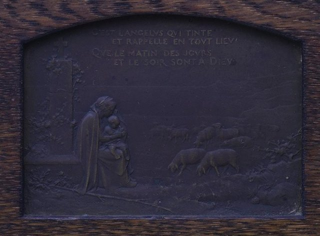 An image of recto: It is the Angelus sounding (C'est l'Angelus qui tinte), verso: A ploughing farmer, accompanied by his dog, stops to pray