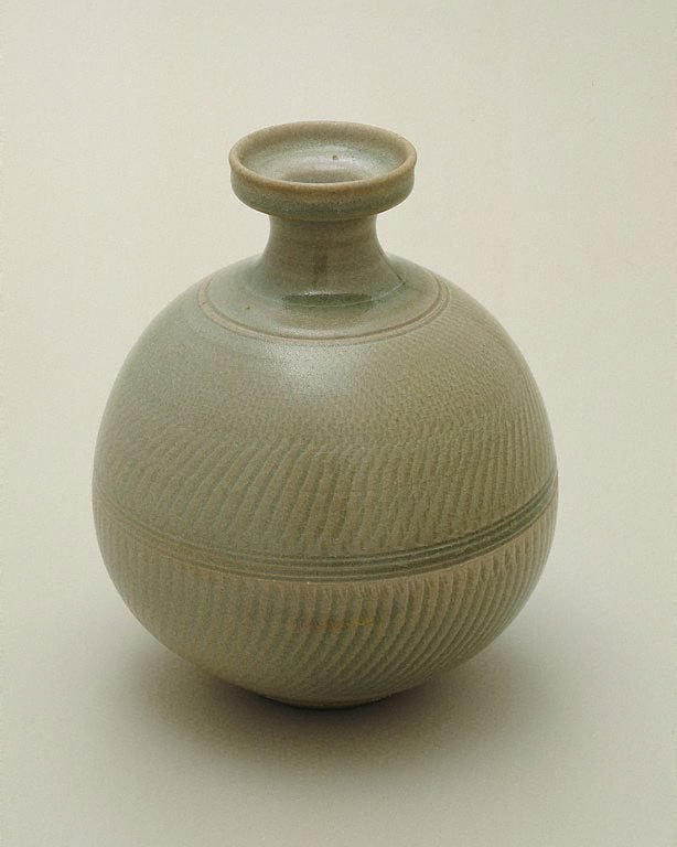 An image of Bottle with celadon glaze and chattered decoration