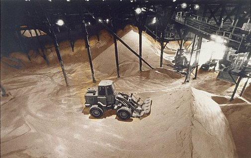 An image of Bulldozing raw sugar by Lewis Morley